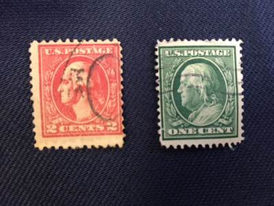 Two cancelled U.S. stamps.