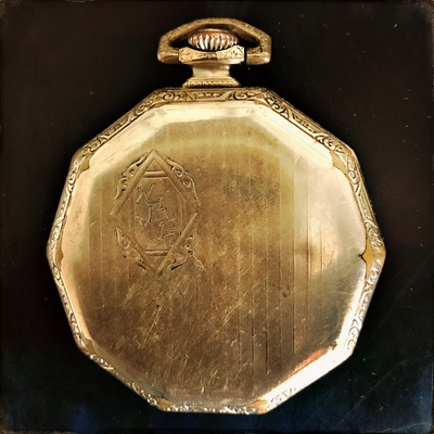 Back of Pocket Watch with initials