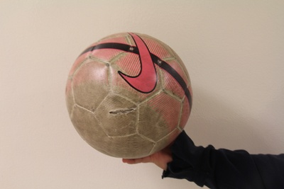 black, white and pink ball with a hole
