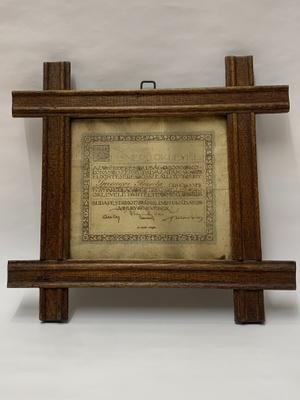 The certificate in its original frame