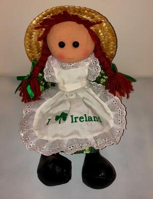A Irish rag doll with straw hat