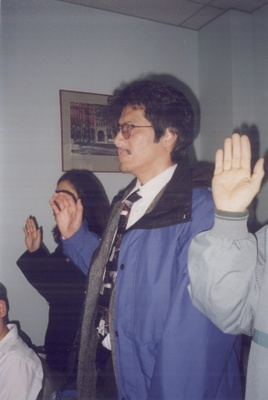 Taking the Oath of Allegiance at a naturalization ceremony