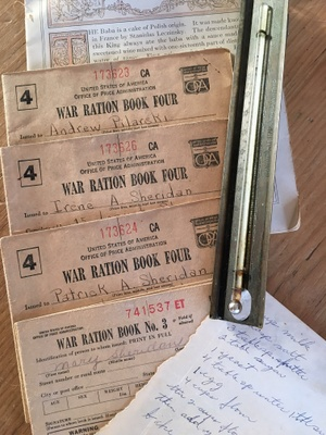 WWII ration books, a sugar thermometer and recipe