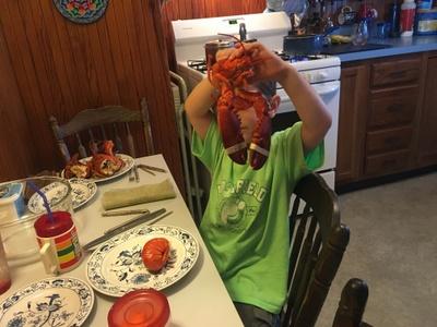 Christian eating lobster.