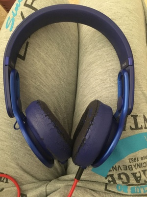 A pair of worn headphones.