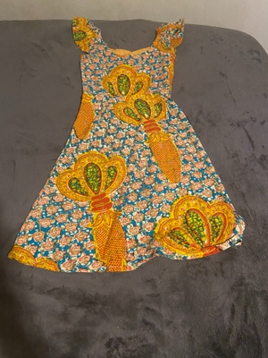 This is a Lappa sewed into a kid dress.