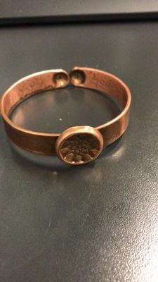 This is a steel pan bracelet.