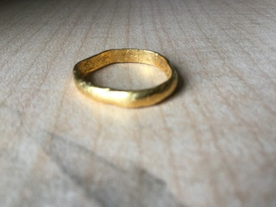 A yellow, misshaped ring.