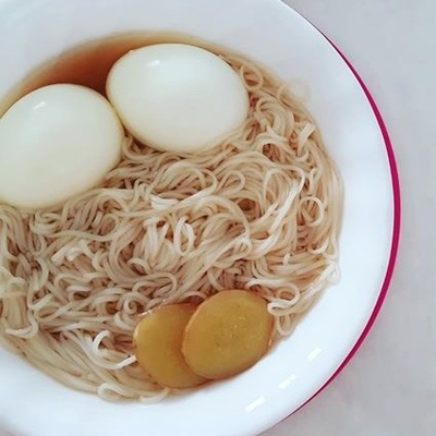A bowl of Chang Shou Mian with two eggs.