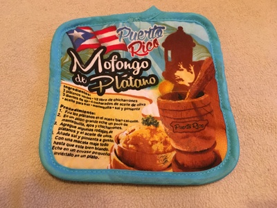 Pot holder with recipe for mofongo, a traditional Puerto Rican dish.