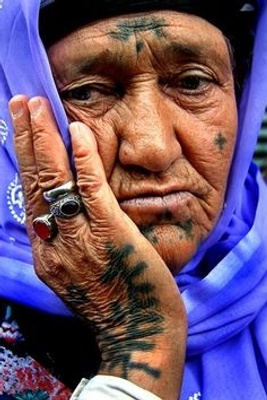 Example of a Kurdish women with tattoos