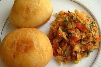 Fried dumplings with saltfish